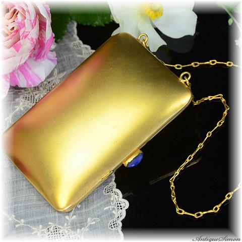 1920年代~30年代のアンティーク品 ゆれるアクセサリー 特注新品ミラー 金箔調の落ち着いた金色 ゆれる鎖 ダンシングコンパクト 瑠璃色ガラスの留め具 堅牢なGerman Silver